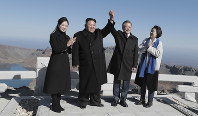 South Korean President Moon Jae-in, second from right, and his wife Kim Jung-sook, right, stand with North Korean leader Kim Jong Un, second from left, and his wife Ri Sol Ju on Mount Paektu in North Korea, on Sept. 20, 2018. (Pyongyang Press Corps Pool via AP)