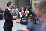 Austrian Chancellor Sebastian Kurz answers questions when arriving at the informal EU summit in Salzburg, Austria, on Sept. 19, 2018. (AP Photo/Kerstin Joensson)