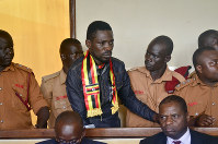 In this Aug. 23, 2018 file photo, Ugandan pop star-turned-lawmaker Kyagulanyi Ssentamu, also known as Bobi Wine, center, arrives at a magistrate's court in Gulu, northern Uganda. (AP Photo)