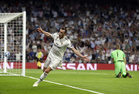 Real midfielder Gareth Bale celebrates after scoring his side's second goal during a Group G Champions League soccer match between Real Madrid and Roma at the Santiago Bernabeu stadium in Madrid, Spain, on Sept. 19, 2018. (AP Photo/Manu Fernandez)