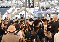 Passengers are seen in the north area of the international departure lobby of Kansai International Airport's Terminal 1, as operations at the airport fully resumed on Sept. 21, 2018. (Mainichi/Naohiro Yamada)