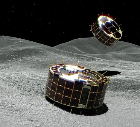An artist's rendering of two robotic probes observing the surface of asteroid Ryugu. (Image courtesy of JAXA)