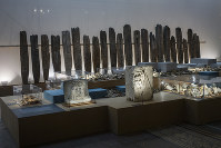 In this Sept. 20, 2018 photo, an archeological exhibition with pieces of the Roman-era is displayed at the Martin-Gropius-Bau museum in Berlin. (AP Photo/Markus Schreiber)