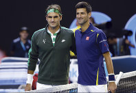 In this Jan. 28, 2016, file photo, Roger Federer, left, of Switzerland and Novak Djokovic, right, of Serbia, pose for a photo ahead of their semifinal match at the Australian Open tennis championships in Melbourne, Australia. (AP Photo/Aaron Favila)