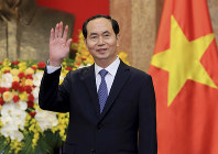 In this March 23, 2018 file photo, Vietnamese President Tran Dai Quang greets journalists as he waits for arrival of Russian Foreign Minister Sergei Lavrov at the Presidential Palace in Hanoi, Vietnam. (AP Photo/Minh Hoang, Pool)