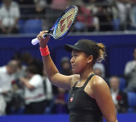 Naomi Osaka of Japan celebrates after defeating Barbora Strycova of the Czech Republic after the quarterfinal match of the Pan Pacific Open women's tennis tournament in Tokyo, on Sept. 21, 2018. (AP Photo/Eugene Hoshiko)