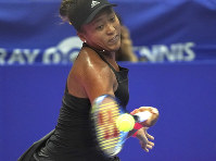 Naomi Osaka of Japan returns a shot against Barbora Strycova of the Czech Republic during the quarterfinal match of the Pan Pacific Open women's tennis tournament in Tokyo, on Sept. 21, 2018. (AP Photo/Eugene Hoshiko)