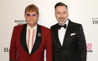 In this March 4, 2018 file photo, Elton John, left, and David Furnish arrive at the 2018 Elton John AIDS Foundation Oscar Viewing Party, in West Hollywood, Calif. (Photo by Willy Sanjuan/Invision/AP)