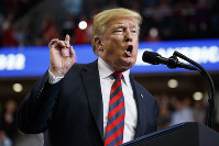 President Donald Trump speaks during a campaign rally, on Sept. 21, 2018, in Springfield, Mo. (AP Photo/Evan Vucci)