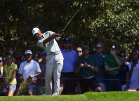 Tiger Woods tees off to the third hole during the second round of the Tour Championship golf tournament on Sept. 21, 2018, in Atlanta. (AP Photo/John Amis)