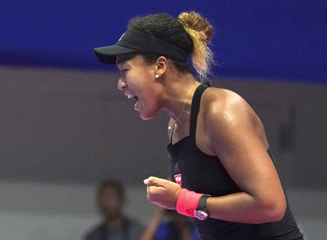 Naomi Osaka of Japan reacts as she won a point against Italy's Camila Giorgi during the semifinal match of the Pan Pacific Open women's tennis tournament in Tokyo on  Sept. 22, 2018. (AP Photo/Eugene Hoshiko)