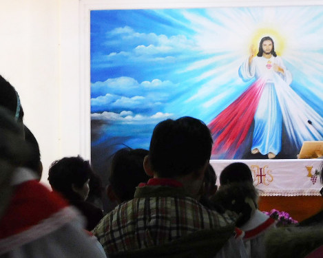 In this file photo dated Feb. 11, 2018, parishioners join in a mass held in a Catholic church in the suburbs of Beijing. (Mainichi)