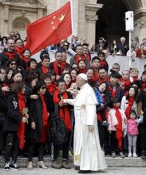 In this April 18, 2018 file photo, Pope Francis meets a group of faithful from China at the end of his weekly general audience in St. Peter's Square, at the Vatican.  (AP Photo/Gregorio Borgia, file)