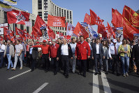 Communist Party leader Gennady Zyuganov, center, attends a rally organized by the Communist Party and other leftist groups against raising the pension age in Moscow, Russia, Saturday, Sept. 22, 2018. (Sergei Sergeyev, Russian Communist Party Press Service via AP)