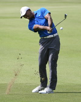 Tiger Woods hits from the first fairway during the third round of the Tour Championship golf tournament Saturday, Sept. 22, 2018, in Atlanta. (AP Photo/John Amis)