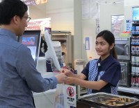 In this file photo dated Sept. 12, 2018, a student from Southeast Asia works as a clerk at a Lawson convenience store in Osaki, in Tokyo's Shinagawa Ward. (Mainichi)