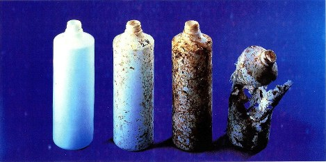 The process of a biodegradable plastic bottle breaking down in compost: from left, before the degradation process begins, two weeks later, four weeks later and six weeks later. (Photo courtesy of the Japan BioPlastics Association)
