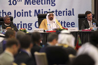 Khalid Al-Falih, minister of Energy, Industry and Mineral Resources of Saudi Arabia, center, speaks during OPEC's 10th meeting of the Joint Ministerial Committee to monitor the oil production reduction agreement of the Organization of the Petroleum Exporting Countries, OPEC, and non-OPEC members, in Algiers, Algeria, on Sept. 23, 2018. (AP Photo/Anis Belghoul)