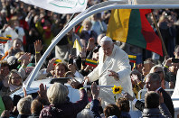 Pope Francis greets people as he arrives for a Mass at Santakos Park, in Kaunas, Lithuania, on Sept. 23, 2018. (AP Photo/Mindaugas Kulbis)