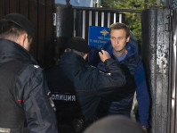Police officers detain Russian opposition activist Alexei Navalny as he leaves a detention center after a month in jail for an unsanctioned protest rally, in Moscow, Russia, on Sept. 24, 2018. (AP Photo/Dmitry Serebryakov)