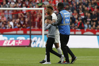 PSG's Neymar shields a crying boy who ran onto the pitch from a security guard after their French League One soccer match between Rennes and Paris-Saint-Germain at Roazhon Park stadium in Rennes, western France, on Sept. 23, 2018. (AP Photo/Michel Euler)
