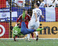 LA Galaxy forward Zlatan Ibrahimovic (9) and Seattle Sounders defender Kelvin Leerdam (18) tangle in front of Seattle goalkeeper Stefan Frei (24) in the first half of an MLS soccer match in Carson, Calif., on Sept. 23, 2018. (AP Photo/Reed Saxon)