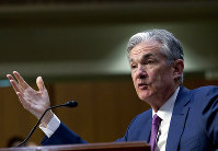 In this July 17, 2018 file photo, Federal Reserve Board Chair Jerome Powell testifies before the Senate Committee on Banking, Housing, and Urban Affairs on