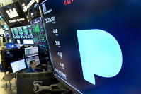 In this Feb. 22, 2018 file photo, the Pandora logo appears above a trading post on the floor of the New York Stock Exchange. (AP Photo/Richard Drew)
