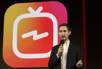 In this June 19, 2018 file photo, Kevin Systrom, CEO and co-founder of Instagram, prepares for an announcement about IGTV in San Francisco. (AP Photo/Jeff Chiu)