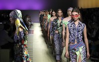 Models wear creations as part of Versace's women's 2019 Spring-Summer collection, unveiled during the Fashion Week in Milan, Italy, on Sept. 21, 2018. (AP Photo/Antonio Calanni)
