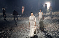 Models wear creations for Christian Dior's Spring/Summer 2019 ready to wear fashion collection presented in Paris, on Sept. 24, 2018. (AP Photo/Christophe Ena)