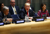 United Nations Secretary General Antonio Guterres, left, and U.S. Ambassador to the United Nations Nikki Haley, right, listen as U.S. President Donald Trump speaks during the