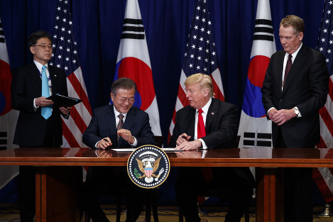 U.S. President Donald Trump and South Korean President Moon Jae-In participate in a signing ceremony for the United States-Korea Free Trade Agreement at the Lotte New York Palace hotel during the United Nations General Assembly, on Sept. 24, 2018, in New York. (AP Photo/Evan Vucci)