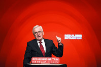 Britain's Shadow Chancellor of the Exchequer John McDonnell speaks during the Labour Party's annual conference at the Arena and Convention Centre (ACC), in Liverpool, England, on Sept. 24, 2018. (Peter Byrne/PA via AP)