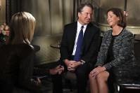 Brett Kavanaugh looks at his wife Ashley Estes Kavanaugh at the start of a FOX News interview with Martha MacCallum, on Sept. 24, 2018, in Washington, about allegations of sexual misconduct against the Supreme Court nominee. (AP Photo/Jacquelyn Martin)
