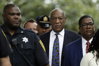 Bill Cosby, center, departs after a sentencing hearing at the Montgomery County Courthouse in Norristown, Pennsylvania, on Sept. 24, 2018. (AP Photo/Matt Slocum)