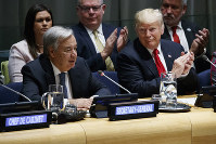 U.S. President Donald Trump listens as United Nations Secretary General Antonio Guterres speaks at the United Nations General Assembly, on Sept. 24, 2018, at U.N. Headquarters. (AP Photo/Evan Vucci)
