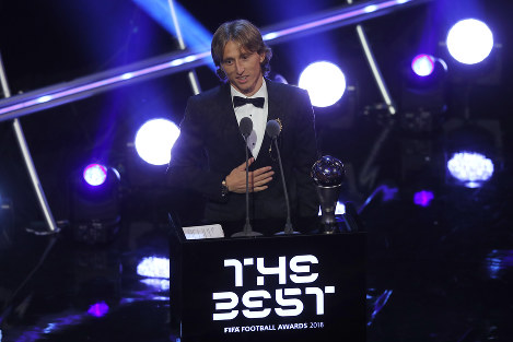 Croatia's soccer star Luka Modric receives the Best FIFA Men's Player Award during the ceremony for the Best FIFA Football Awards in the Royal Festival Hall in London, Britain, on Sept. 24, 2018. (AP Photo/Frank Augstein)
