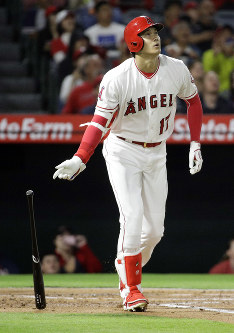 Los Angeles Angels' Shohei Ohtani, of Japan, watches his home run against the Texas Rangers during the first inning of a baseball game in Anaheim, California, on Sept. 24, 2018. (AP Photo/Chris Carlson)