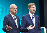 In this Jan. 13, 2014 file photo, Mercedes-Benz marketing chief Ola Kallenius, right, stands with Daimler Chairman Dieter Zetsche at the end of a press conference at the North American International Auto Show in Detroit, Michigan. (AP Photo/Tony Ding)
