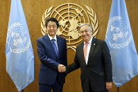 Japan's Prime Minister Shinzo Abe meets with United Nations Secretary-General Antonio Guterres on the sidelines of the 73rd session of the United Nations General Assembly, at U.N. headquarters, on Sept. 25, 2018. (AP Photo/Jason DeCrow)