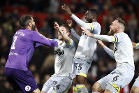 Derby County goalkeeper Scott Carson, left, celebrates winning the penalty shootout with team mates during the match against Manchester United during the English League Cup, third round soccer match at Old Trafford in Manchester, England, on Sept. 25, 2018. (Martin Rickett/PA via AP)