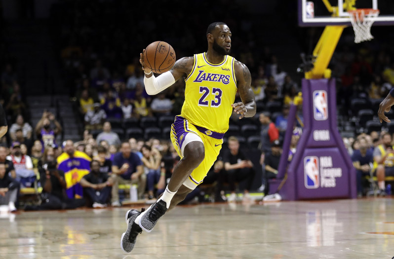 edcaec6ae8f09 Los Angeles Lakers forward LeBron James dribbles during the first half of  an NBA preseason basketball game against the Denver Nuggets
