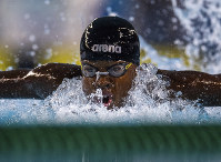 Mali swimmer Ousmane Toure competes in the Men's 100m Butterfly Heat at the Natatorium during the Youth Olympic Summer Games in Buenos Aires, Argentina, on Oct. 8, 2018. (Joel Marklund/OIS/IOC via AP)