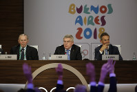 International Olympic Committee President Thomas Bach, center, leads the poll to elect Senegal to host the 2022 Youth Olympic Games during the 133th IOC session in Buenos Aires, Argentina, on Oct. 8, 2018. (AP Photo/Natacha Pisarenko)
