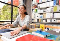 これまで手掛けた作品を前に「思いと共に仕事してるんで」と語る築山万里子さん=大阪市中央区のアサヒ精版印刷で、川平愛撮影