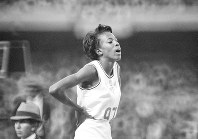 In this Oct. 19, 1968, file photo, United States' Madeline Manning catches her breath after winning the women's 800-meter run in record time of 2:00.9, at the Olympics in Mexico City. (AP Photo/File)