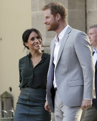 In this Oct. 3, 2018 file photo, Britain's Prince Harry, right, and Meghan, Duchess of Sussex, visit the Pavilion Building in Brighton, Britain. (AP Photo/Tim Ireland)