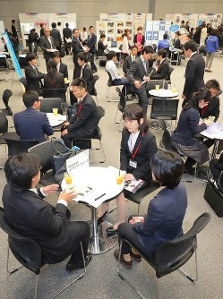 University students talk with company employees during a career fair organized by the Osaka Prefectural Government in Osaka's Kita Ward on Oct. 27, 2017. (Mainichi)