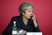 Britain's Prime Minister Theresa May attends a roundtable meeting with business leaders whose companies are inaugural signatories of the Race at Work Charter at the Southbank Centre in London, on Oct. 11, 2018. (Henry Nicholls/Pool via AP)